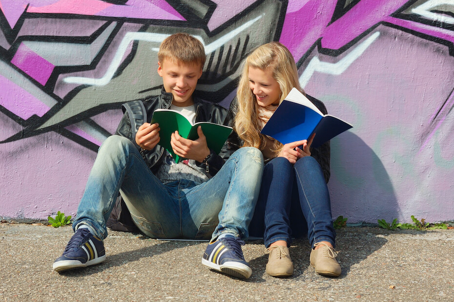 shutterstock-boy-girl-couple-reading-studying-together-121319