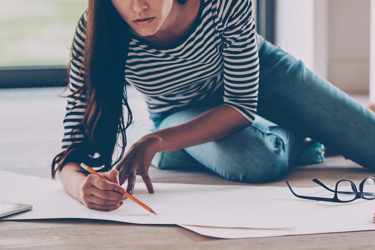 shutterstock-woman-on-floor-drawing-sketching