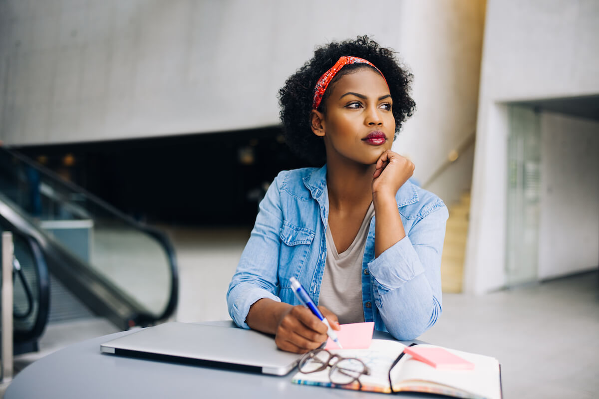 shutterstock-woman-writing-thinking-about-someone