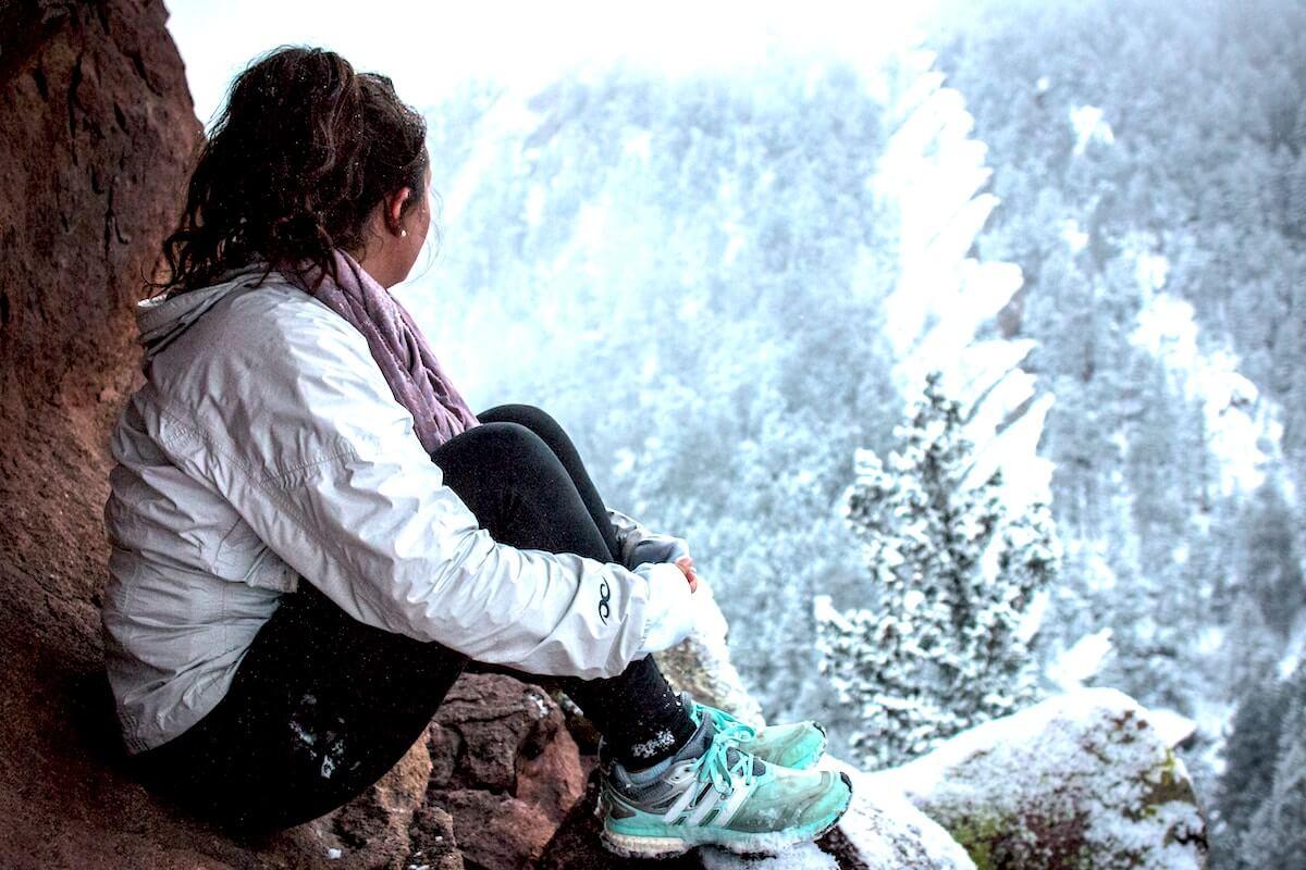 unsplash-eric-nopanen-woman-snow-mountain-climbing