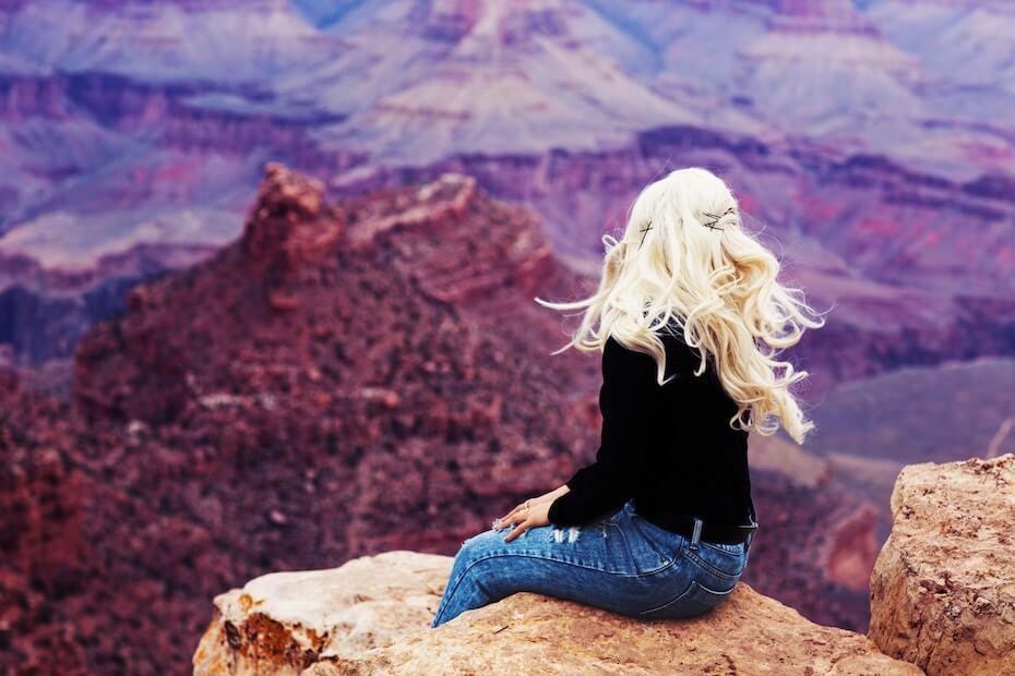 unsplash-sami-hobbs-woman-sitting-on-cliff-overlooking-mountains-120219