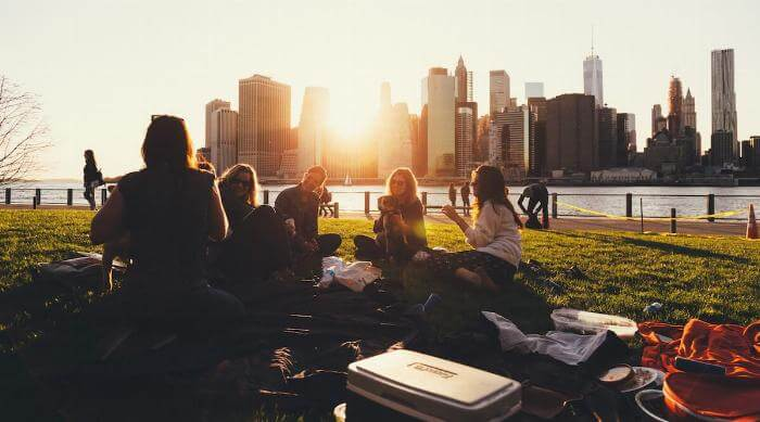 Friends Having a Picnic in a Park