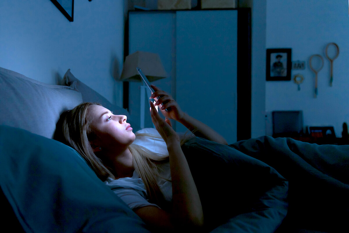 shutterstock-girl-cant-sleep-looking-at-phone-texting