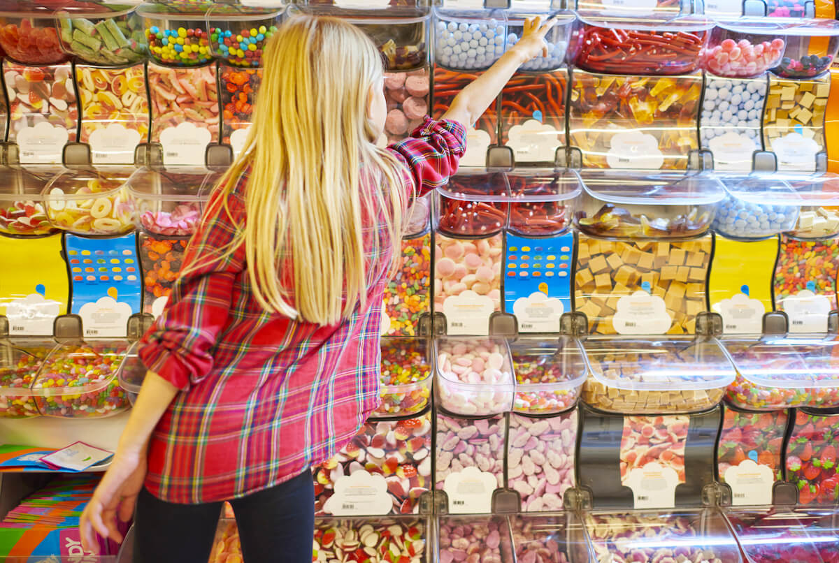 shutterstock-girl-reaching-for-candy-at-store