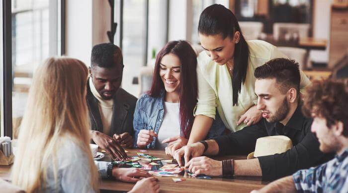 Shutterstock: Group of friends playing board game social