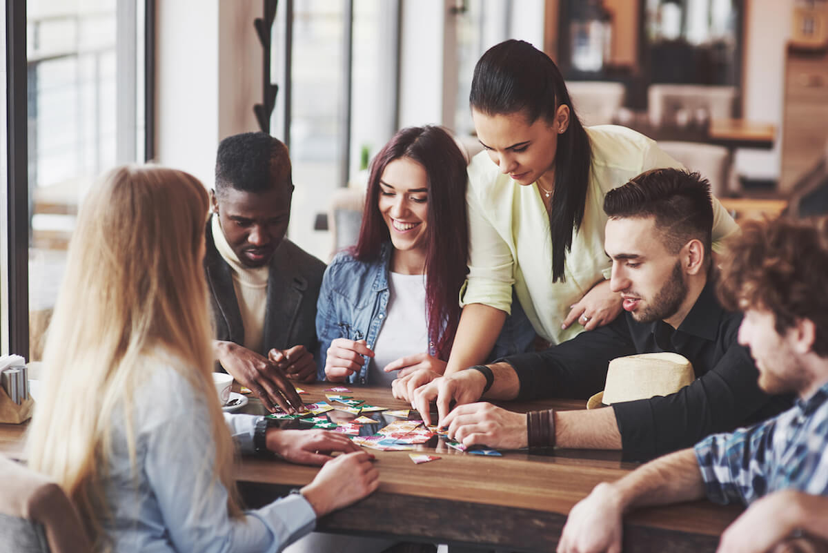 shutterstock-group-of-friends-playing-board-game