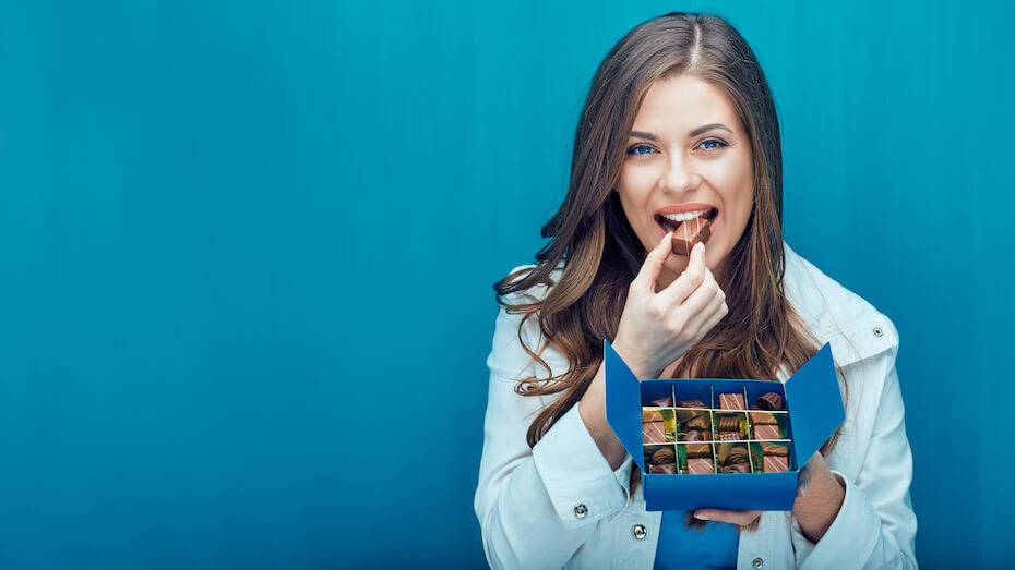 shutterstock-woman-eating-from-box-of-chocolates-022820