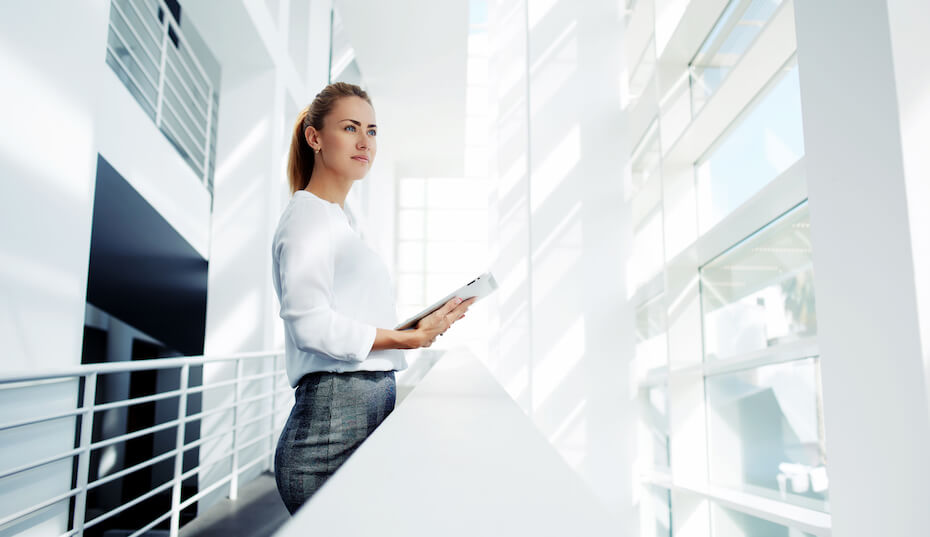 Shutterstock: Woman looking proud with tablet against white background at Getty Center