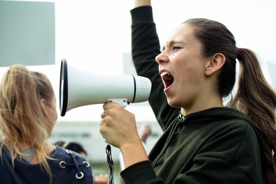 shutterstock-woman-shouting-into-megaphone-activist-012820