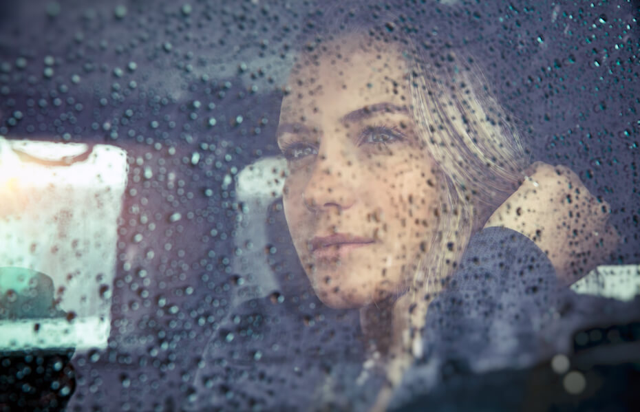 shutterstock-woman-staring-out-rainy-car-window-011420