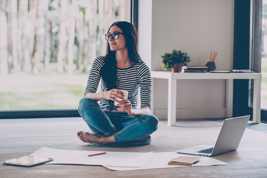 shutterstock-woman-working-on-project-striped-shirt-010820