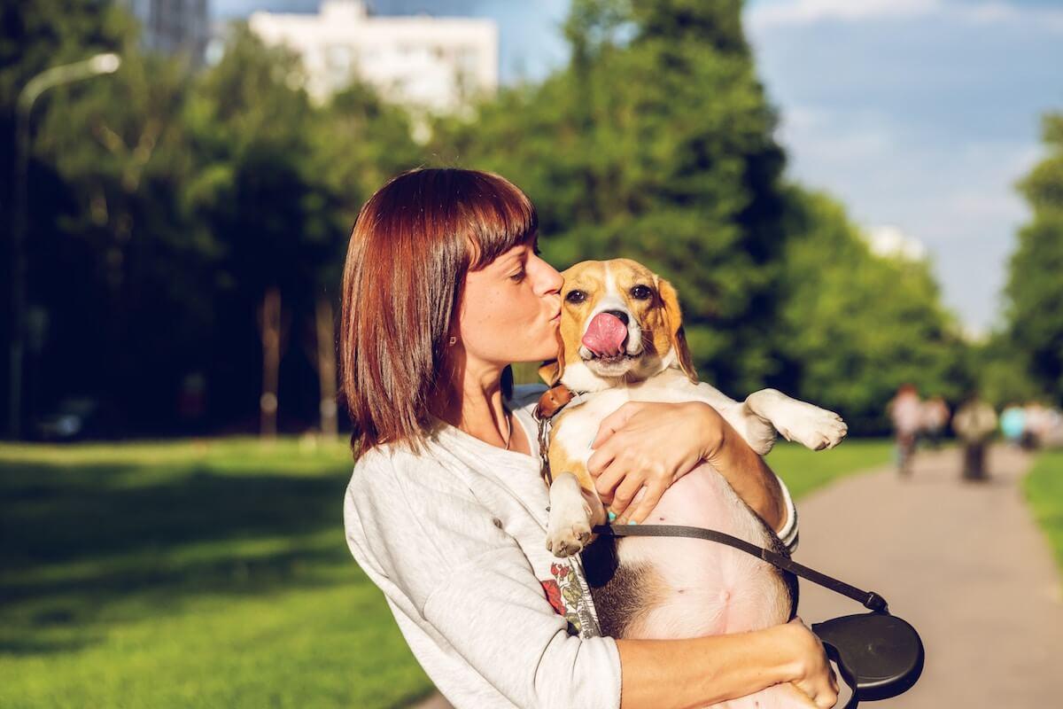 Unsplash: Woman kissing cute dog