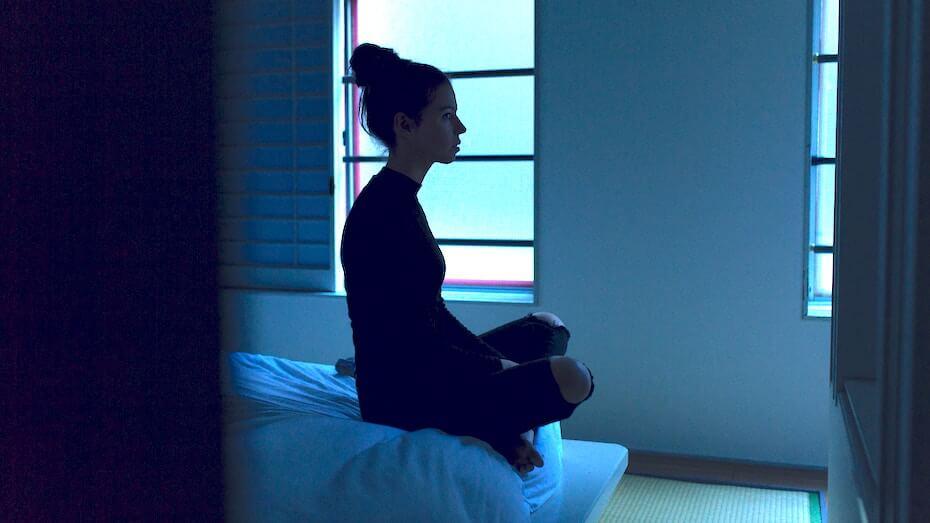 unsplash-ben-blennerhassett-woman-sitting-up-at-edge-of-bed-cant-sleep-013120