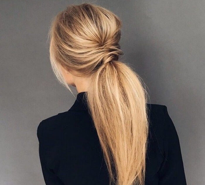 JCPenney Salon: Blonde woman with voluminous ponytail