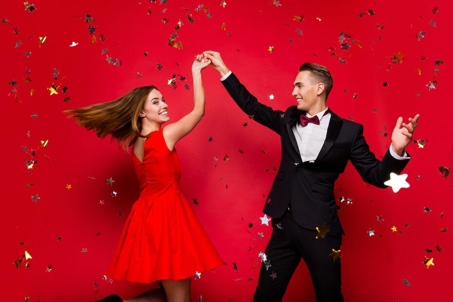 shutterstock-couple-an-woman-twirling-formal-dress-star-confetti-022820