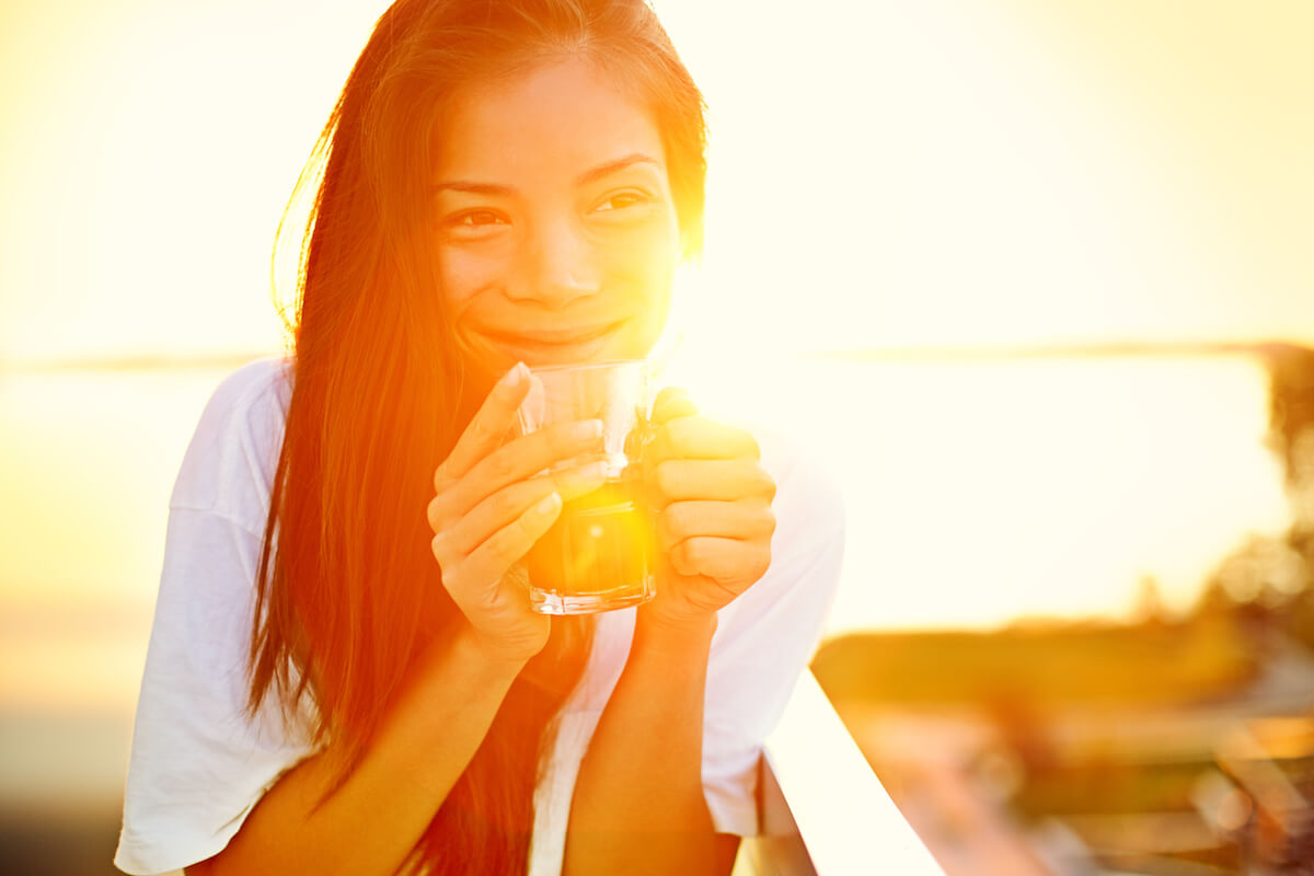 shutterstock-girl-sipping-drink-at-sunrise-sunset