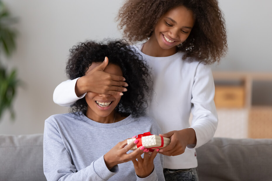 shutterstock-girl-surprising-mom-with-gift-022620