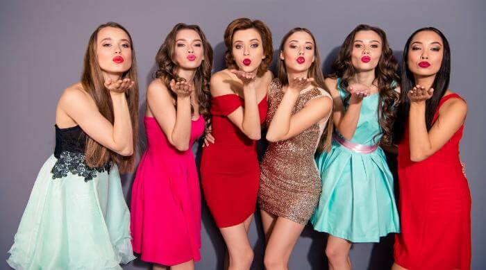 Shutterstock: Girls in prom dresses blowing kisses at camera