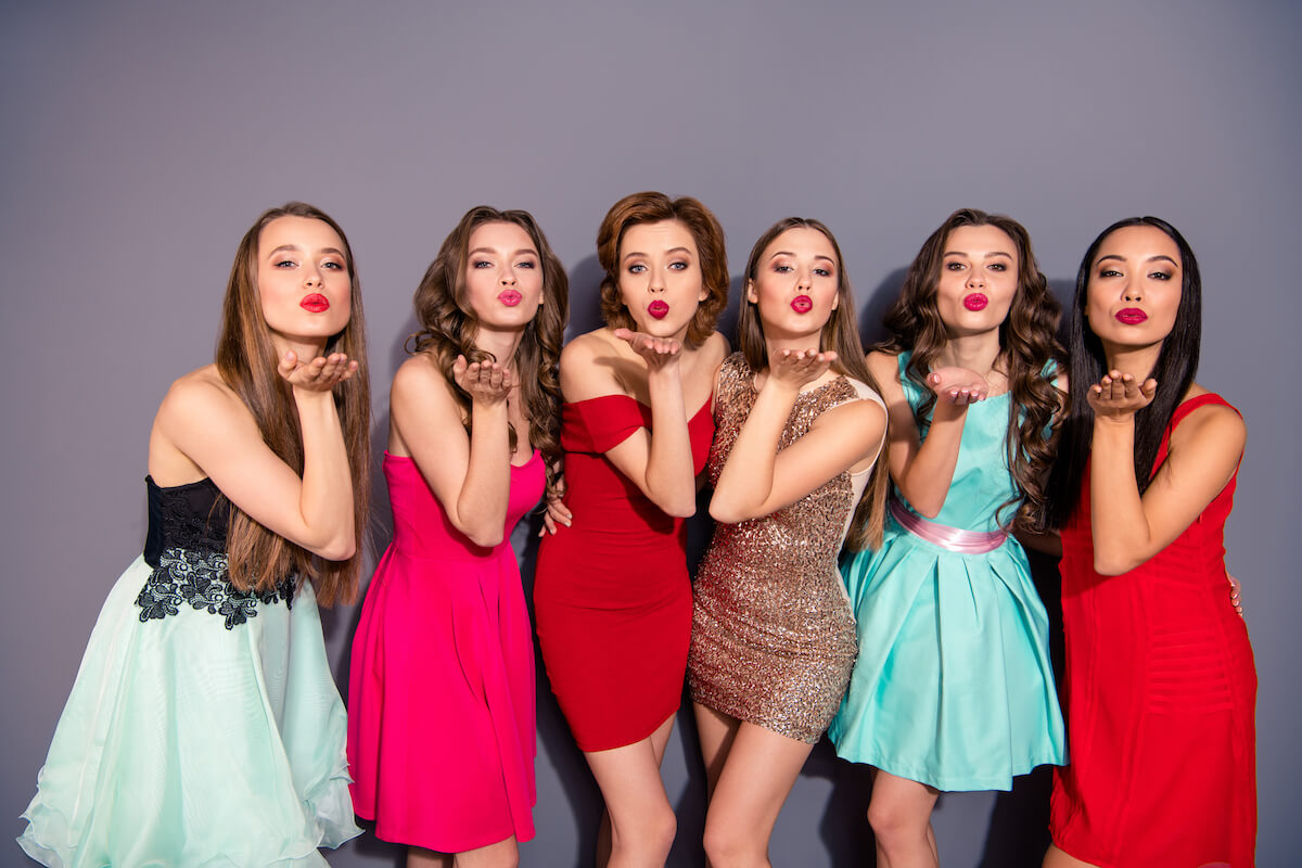 shutterstock-girls-in-prom-dresses-blowing-kisses