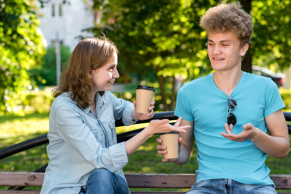 shutterstock-guy-and-girl-laughing-chatting-coffee-022120