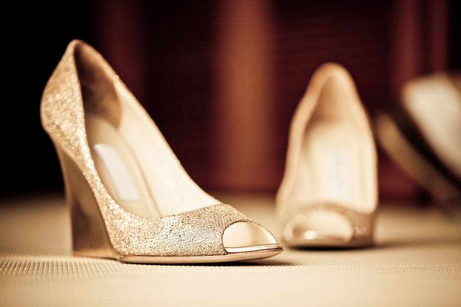 shutterstock-sparkly-pair-of-wedge-shoes-021320