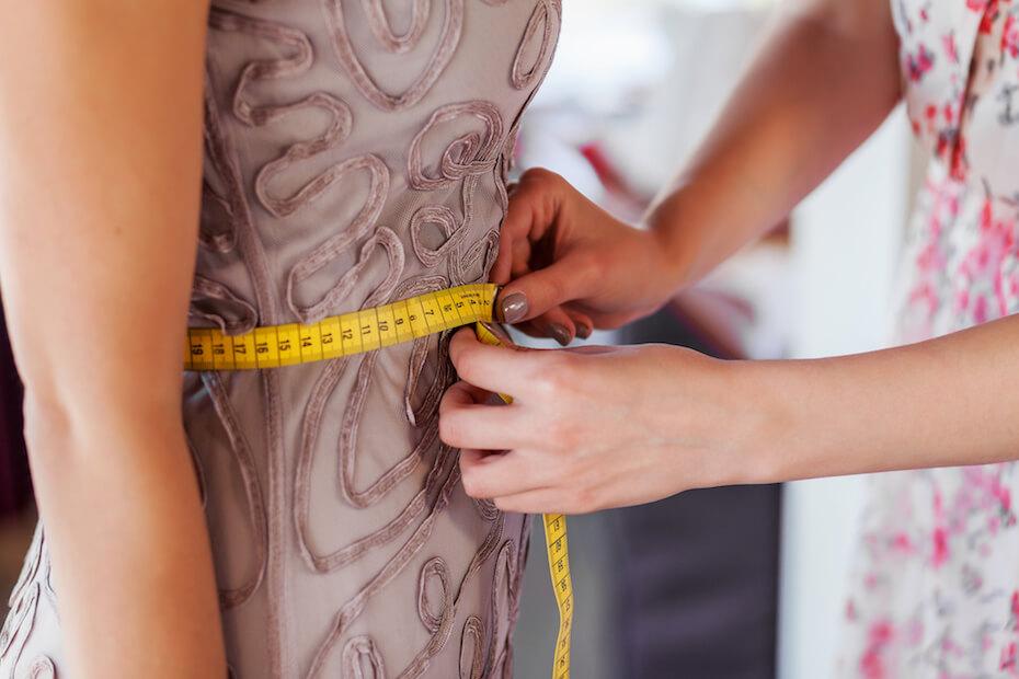 shutterstock-tailor-measuring-prom-dress-stomach-022420