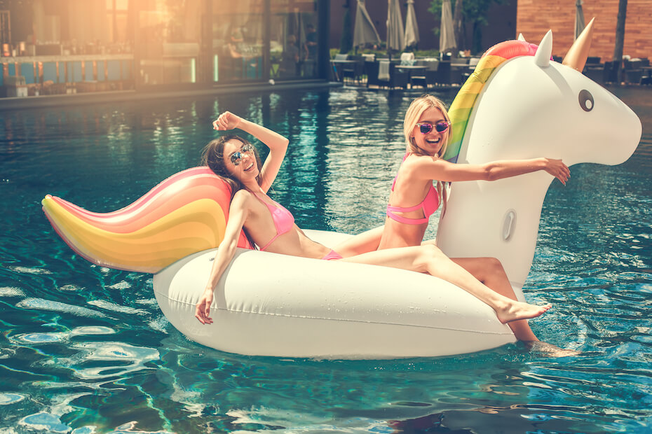 shutterstock-two-friends-riding-unicorn-inflatable-pool-toy-022120