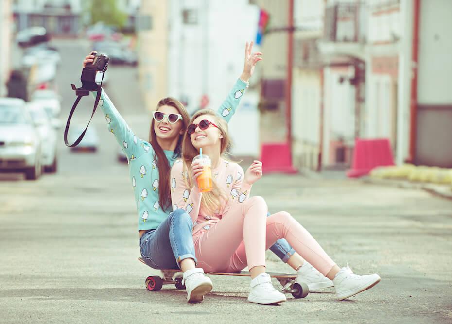 shutterstock-two-women-pastel-colors-skateboard-selfie-boba-021920