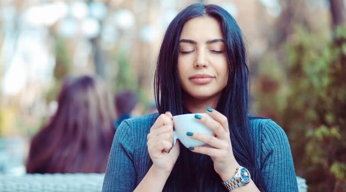 Shutterstock: Woman enjoying cup of tea or coffee