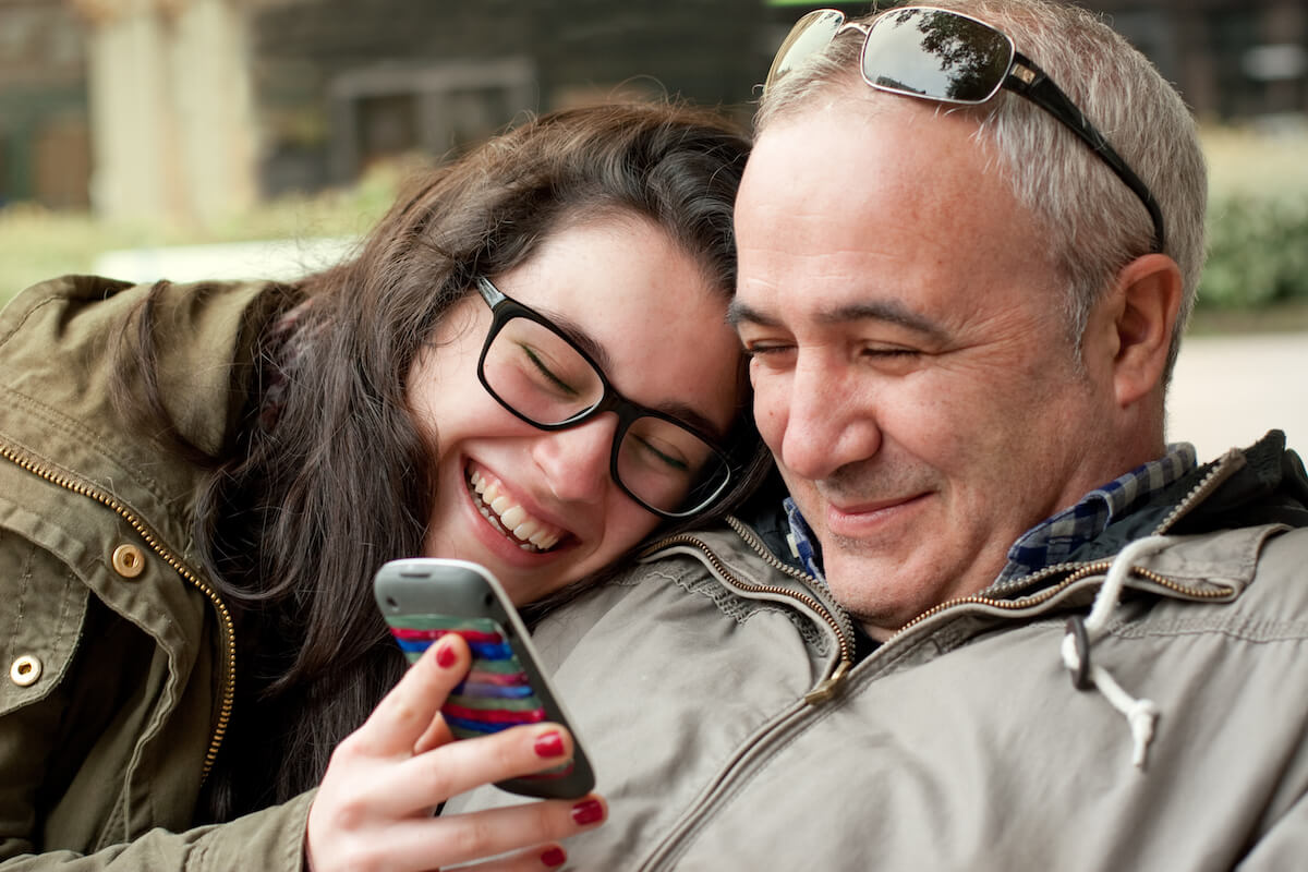 shutterstock-woman-holding-up-phone-to-show-to-dad