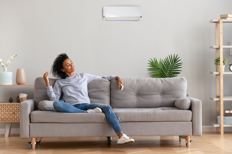 shutterstock-woman-on-couch-smiling-thinking-daydreaming-022420
