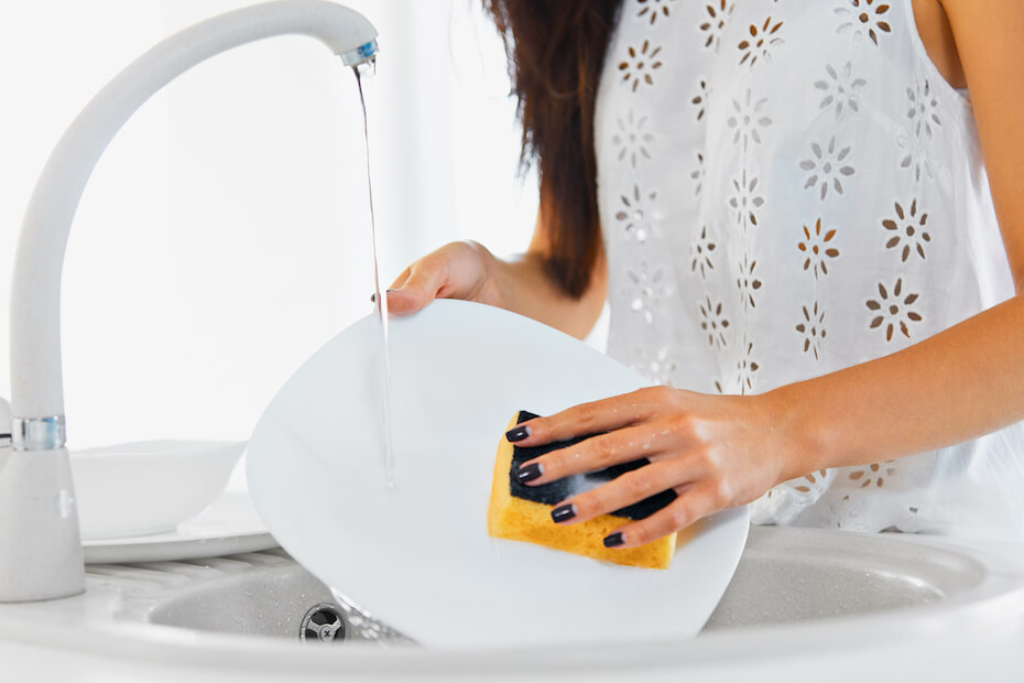 shutterstock-woman-washing-dishes-with-manicure-021020
