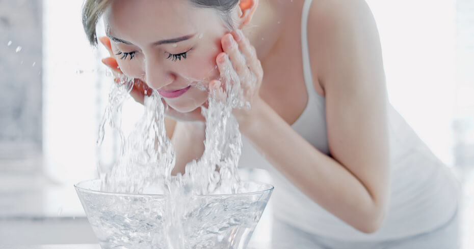 shutterstock-woman-washing-face-over-bowl-of-water-022720