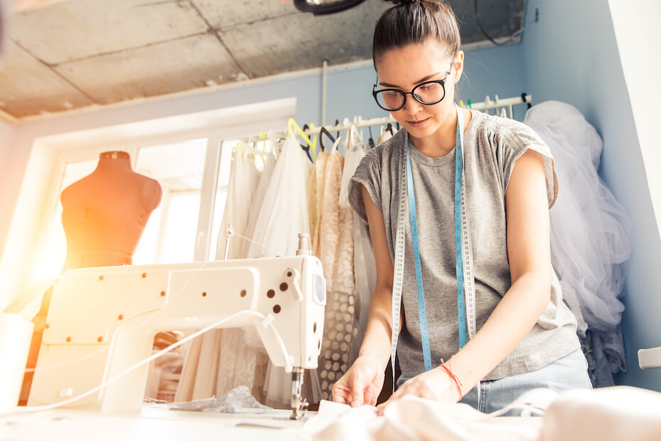 shutterstock-woman-with-glasses-sewing-altering-dress-022420