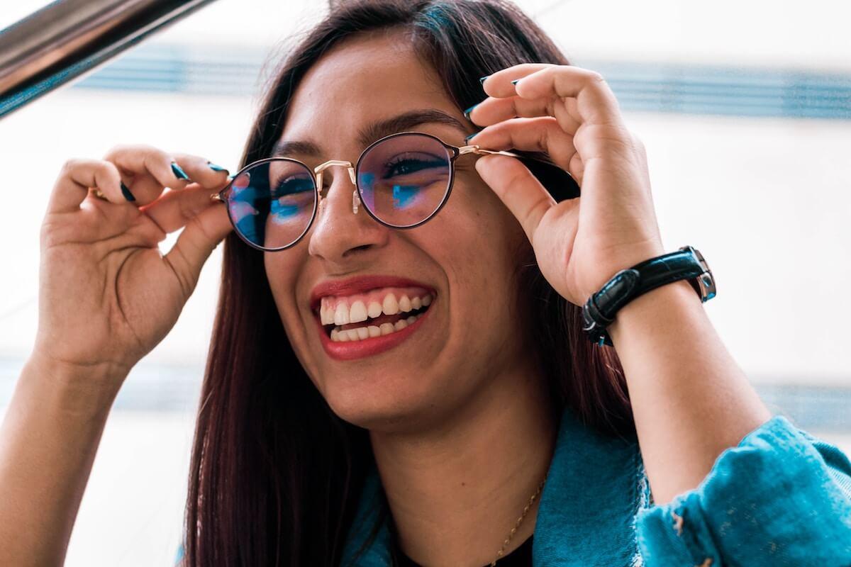 unsplash-susan-duran-smiling-woman-with-glasses