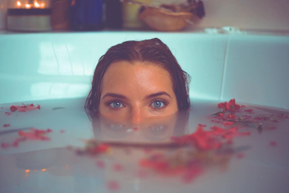 unsplash-timothy-dykes-woman-peeking-out-of-spa-tub-020420