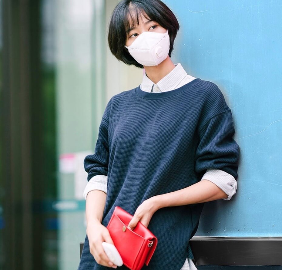 Airpop: Model wearing simple pink face mask