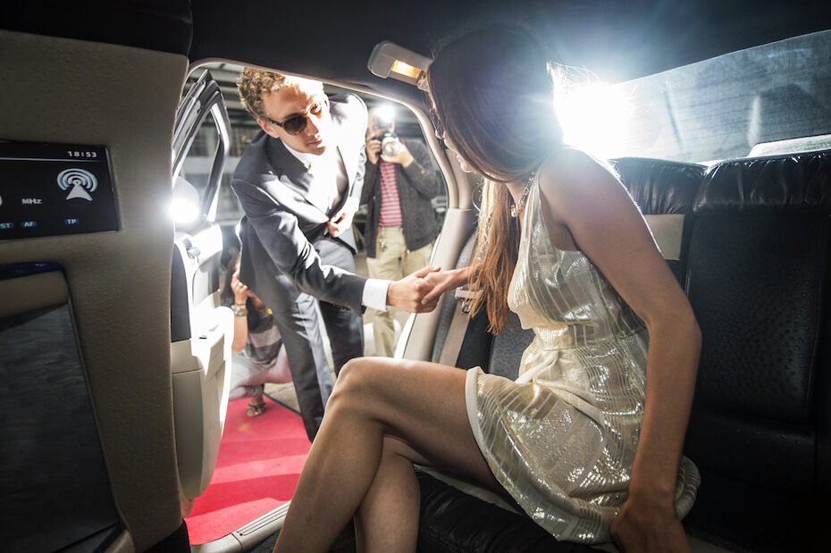 shutterstock-girl-in-limo-getting-let-out-by-man-red-carpet-030420