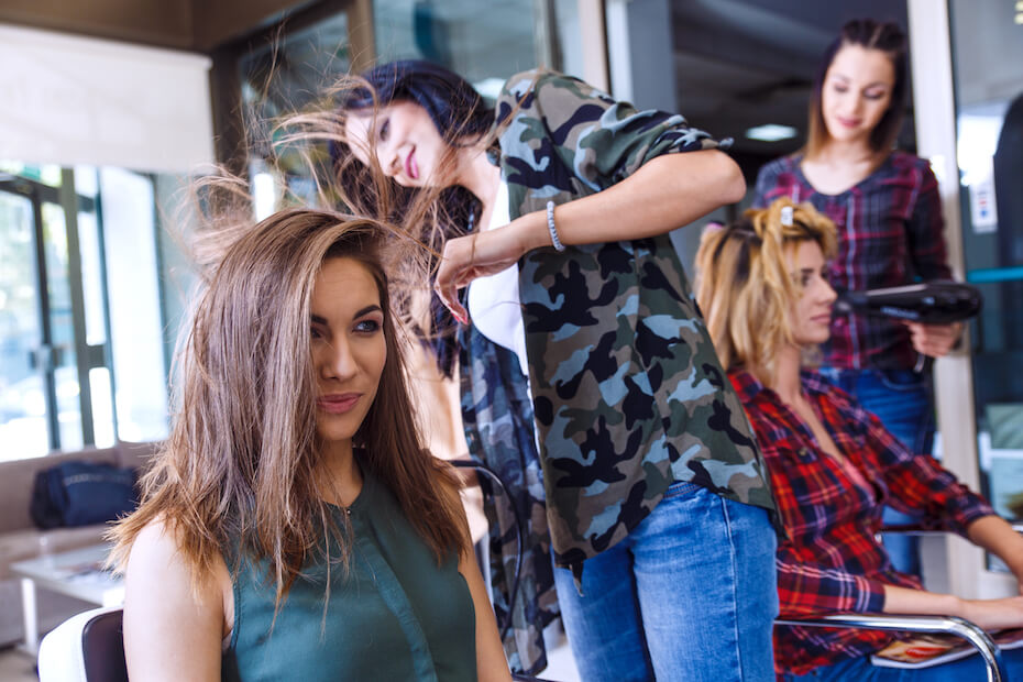 shutterstock-two-friends-getting-hair-done-at-salon-together-030420