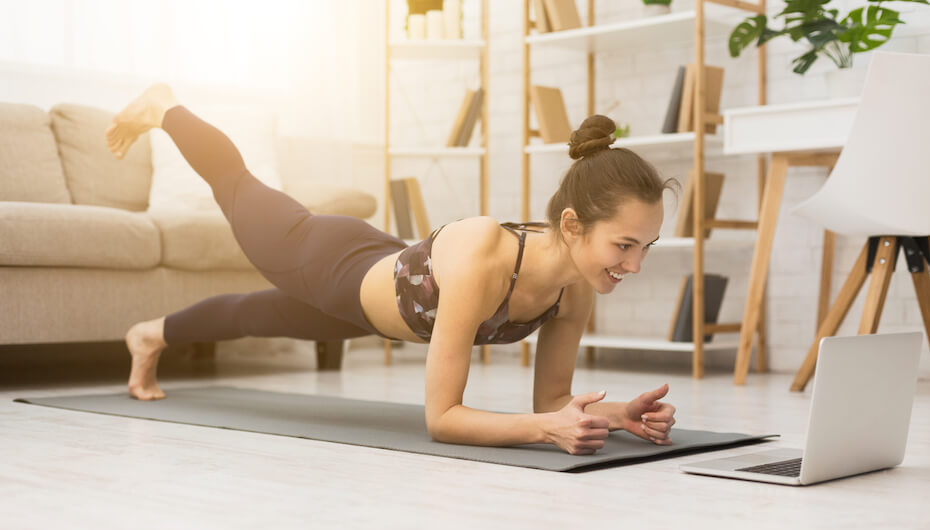 shutterstock-woman-exercise-planks-home-031720