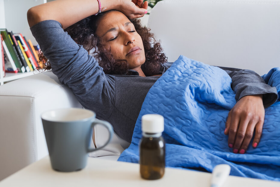 shutterstock-woman-feeling-sick-in-bed-with-fever-032620