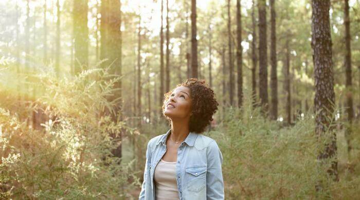 Shutterstock: Woman in nature forest with sunlight social