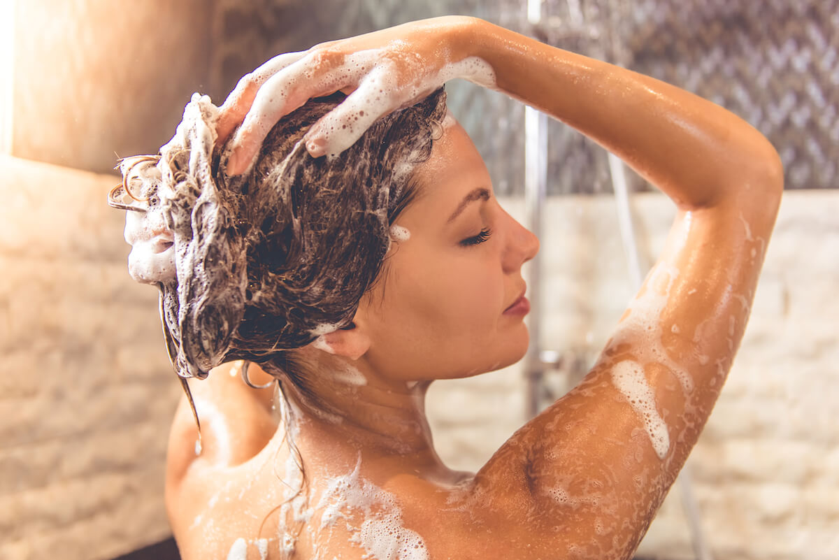Shutterstock: Woman lathering hair in shower