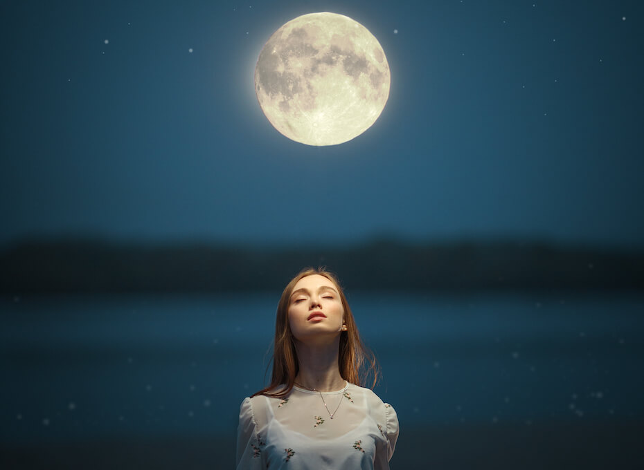 shutterstock-woman-looking-up-at-full-moon-033020