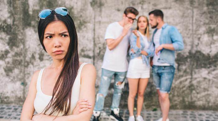 Shutterstock: Woman upset with friends taking behind her back and spreading rumors