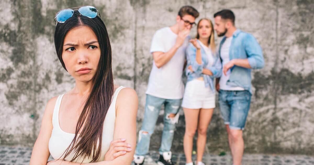shutterstock-woman-upset-talking-behind-back-rumors-social-031920