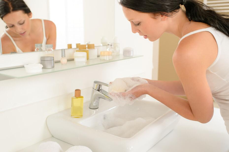 shutterstock-woman-washing-hands-lathering-in-sink-032620