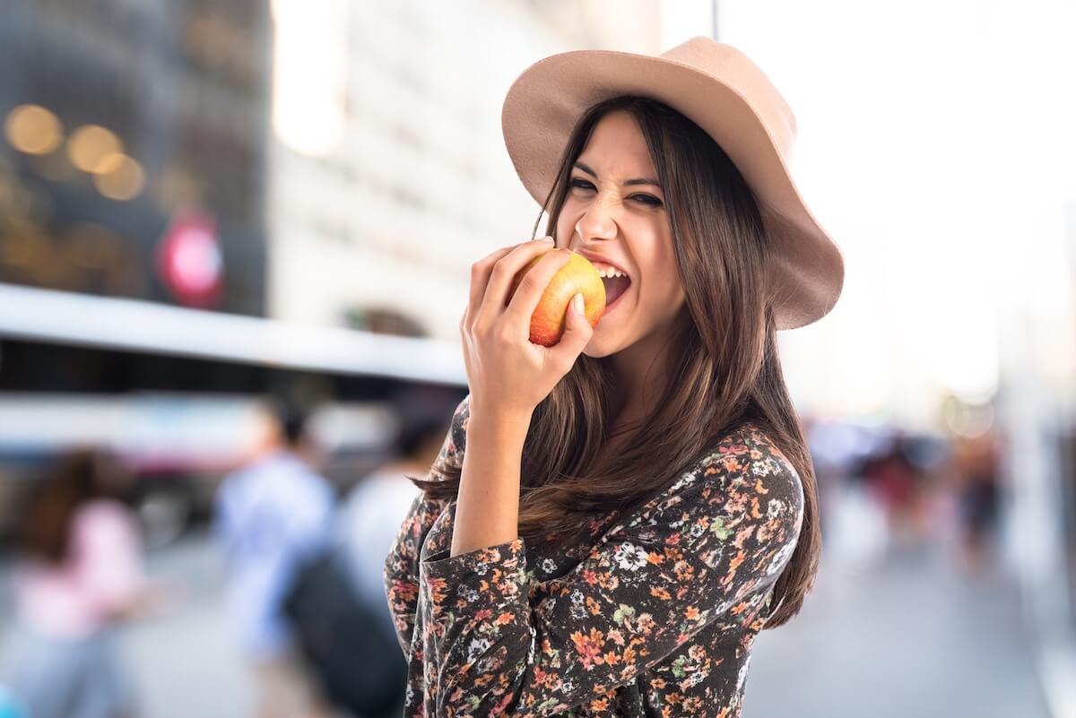 shutterstock-woman-wearing-hat-eating-apple