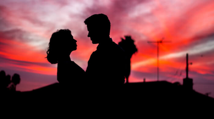 Couple backlit by sunset