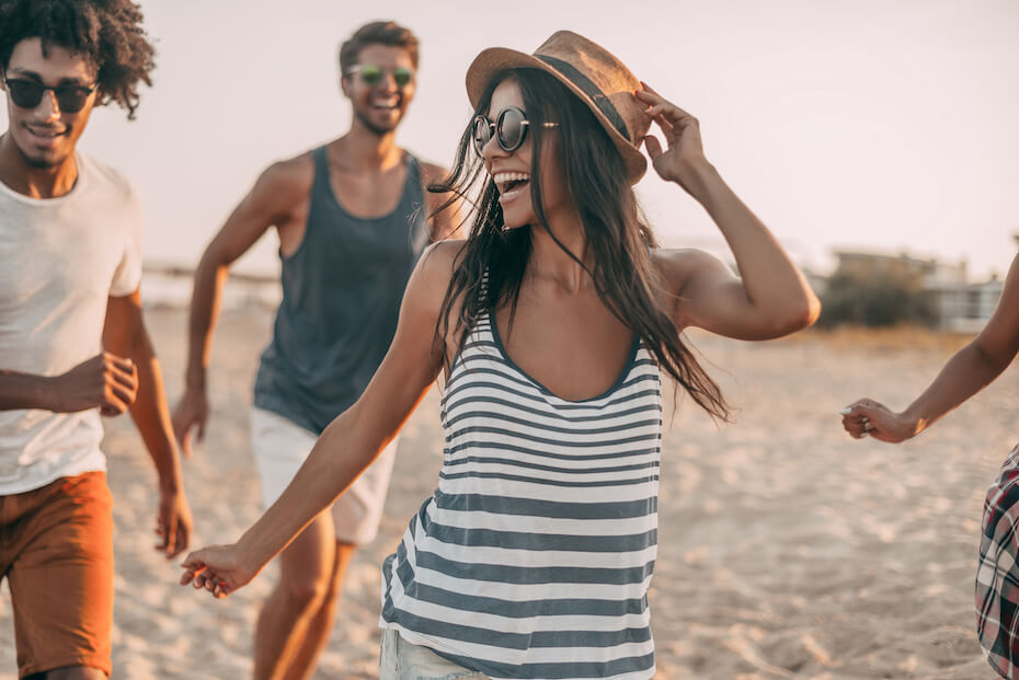 shutterstock-friends-men-women-laughing-running-at-beach-040920